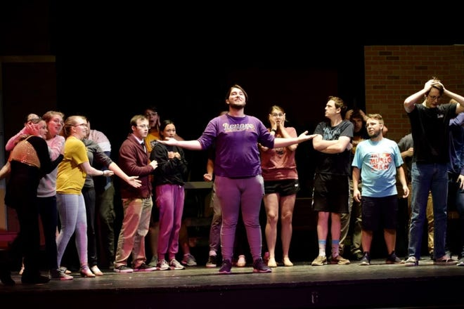 """Harold Hill, played by Braydon Boyer (center), leads the cast of """"The Music Man"""" during rehearsal on Sept. 30 for Fort Hays State University."""