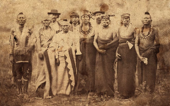 Photograph (black and white) from an album; studio portrait of a group of Osage men