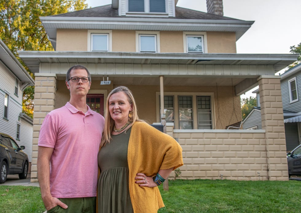 Dan and Jackie Armich pose in front of their home at 1514 W. Columbia Terrace that they've been renting out as an Airbnb for months in the Uplands neighborhood of Peoria. The couple was shocked when the Peoria City Council voted on Sept. 14 against allowing them to continue the short-term rental program.