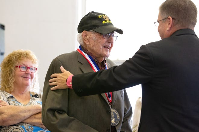 Wilburn Rowden accepts a medal to commemorate his induction to the Missouri National Guard Hall of Fame during a ceremony on Friday, Oct. 1 in Kirksville.