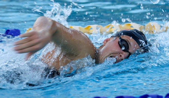 Lakeland senior Olivia Vignec swims the 100-yard freestyle en route to setting a meet record on Wednesday at the 32 annual City of Lakeland Championships at Gandy Pool in Lakeland.