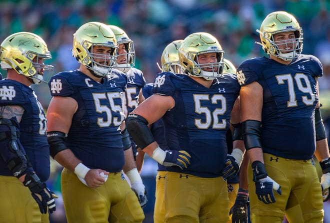Notre Dame offensive linemen wait for the play call from their quarterback during the Notre Dame-Purdue game on Saturday, Sept. 18, 2021, at Notre Dame Stadium.