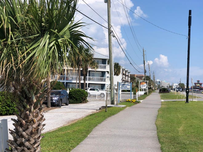 Condominiums line Scenic Gulf Drive in Miramar Beach, where development pressures have raised concerns for many residents.
