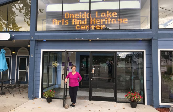 Founder and President Linda Verni Williams stands in front of the brand new Oneida Lake Arts and Heritage Center Sept. 30 in Sylvan Beach. She plans to create a true community center attracting residents there from a four-county area.