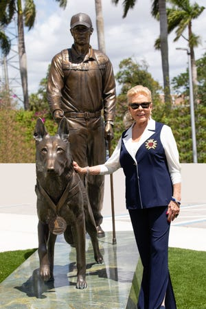 Lois Pope at the Military Dog monument