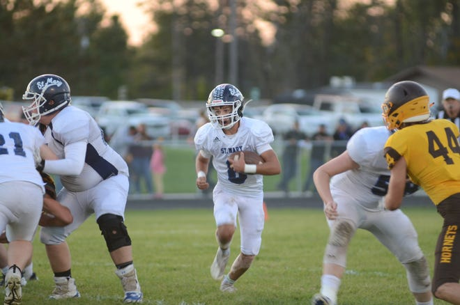 St. Mary quarterback, Gavin Bebble, runs the ball in the first half against Pellston. Bebble rushed for 103 yards in the 34-8 loss to their conference rival.