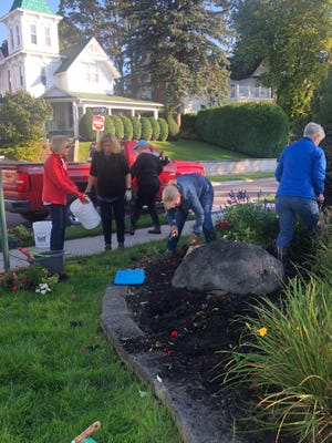 Last week, over 40 members of the Harbor Springs Garden Club transitioned the gardens to fall colors of red, yellow, and bronze.
