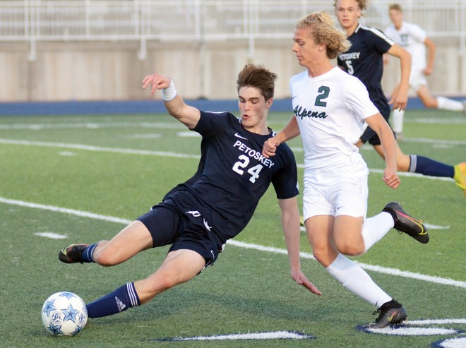 Petoskey's Nik Taylor makes a sliding move to disengage the ball from an Alpena player during the first half Thursday.