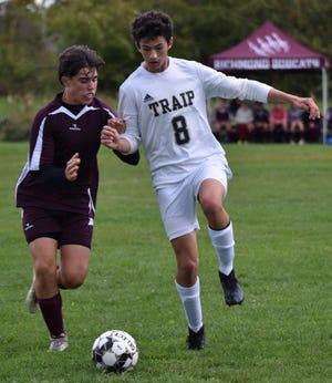 Traip's Owen Woolacott, right, shields a Richmond player from the ball during Thursday's boys soccer match.