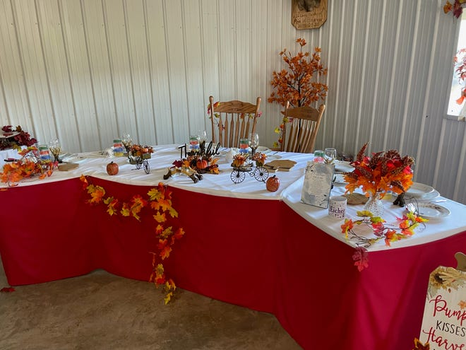 Festive fall table decorations have been prepared for Loretta and Dustin's wedding.