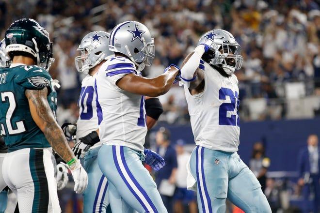 Philadelphia Eagles safety Marcus Epps, left, looks on as Dallas Cowboys running back Ezekiel Elliott (21) celebrates his touchdown run in the first half in Arlington on Monday.