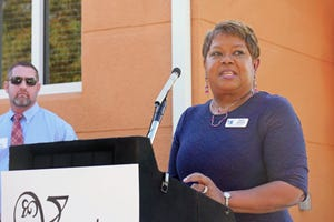 Aundria Castleberry, who is still an active member of the Venice Housing Authority board, addresses the crowd Friday, after Castleberry Court, the main street for Venetian Walk II, was named in her honor at the grand opening ceremony for the new affordable housing development.