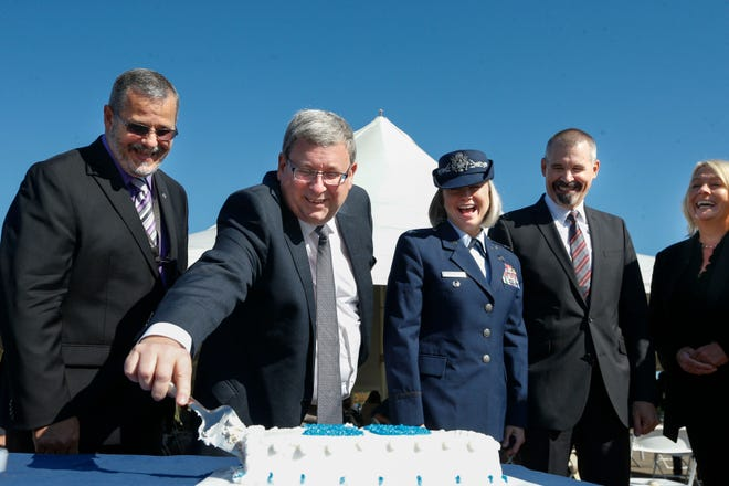 From left and right: Mike Murasky, site director, Rick Platt, CEO of the Port Authority, cuts the 25th anniversary cake with Colonel Lea Kirkwood, Carl Unholz, Director of Air Force Metrology and Calibration Program, and Cindy Gruensfelder, Vice President of the after a ceremony for the Boeing Guidance Repair Center at the Central Ohio Aerospace and Technology Center in Heath, Ohio, on Friday, Oct. 1, 2021. Many speakers talked about the importance of keeping jobs at this center for the people of central Ohio.