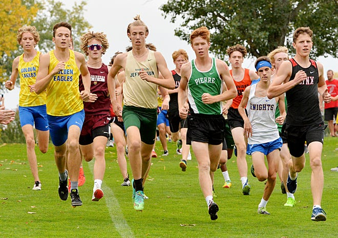 Aberdeen Central runner Josh Martin, left, leads out Central at the start of the race at the Watertown Watoma Invitational on Thursday.
