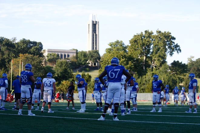 Kansas offensive linemen break out from team stretching at a practice this fall in Lawrence.