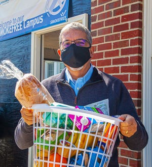 QCC President Luis G. Pedraja, Ph.D., was a regular HomePlate Food Pantry volunteer and helped to distribute food to students in a contact-free way each week during the pandemic.