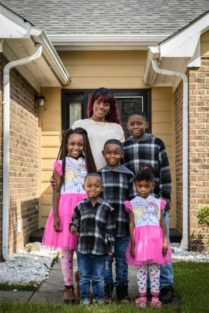 Carrie Williams, pictured with her children, had to quit her job at Fort Bragg this past year after her children tested positive for COVID-19. She's finding that because she receives veteran benefits, she is ineligible for assistance despite falling behind on her rent.
