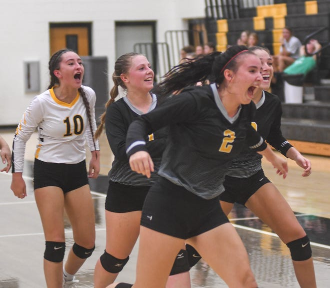 Glencoe's Bri Beyerle (2) and teammates run off the court celebrating after beating Hokes Bluff in four sets in high school volleyball on Thursday, Sept. 30, 2021, in Glencoe.