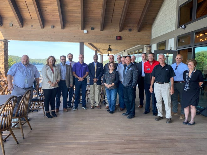 The Columbus to Pittsburgh Corridor Association recently hosted a bus tour of the corridor for Jack Marchbanks, director of the Ohio Department of Transportation. Those on the tour are pictured at the new Tappan Marina in Harrison County.