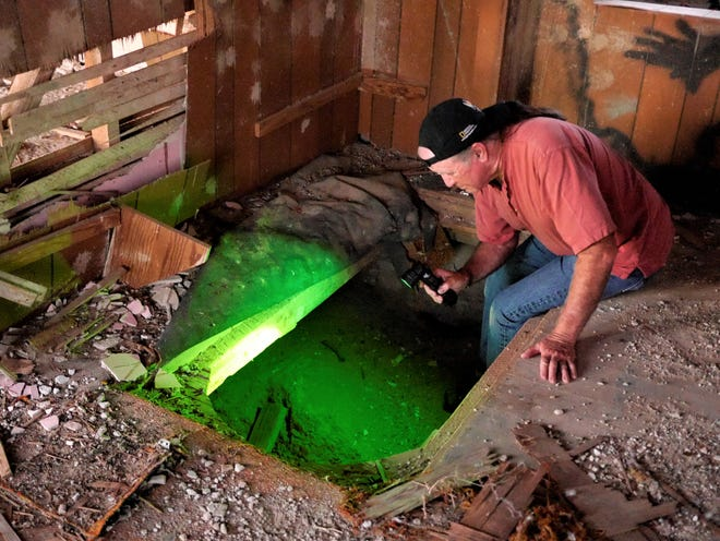John checks out the basement of an abandoned farmhouse for signs of paranormal activity.