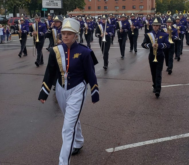 The Watertown High School band marches down Kemp Avenue during Friday's homecoming parade.