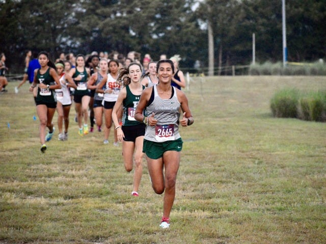 Waxahachie sophomore Emilee Jones leads the pack during a recent cross-country meet. Jones finished second on Thursday in the Elite division of the Ken Gaston Invitational at Lynn Creek Park in Grand Prairie, site of the District 11-6A meet on Oct. 14.
