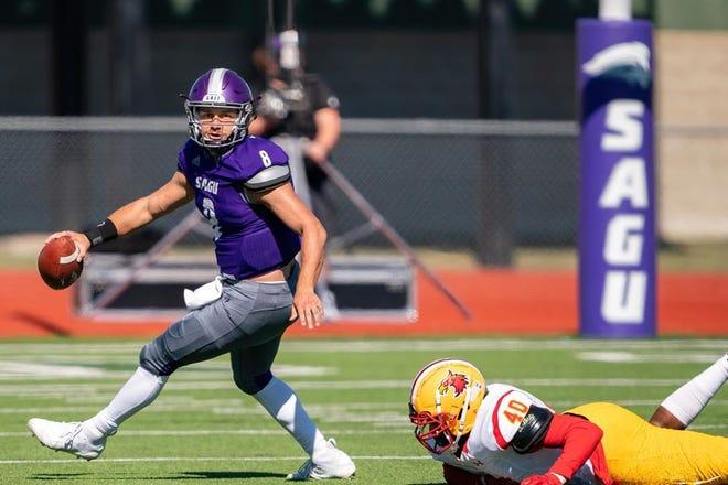 SAGU quarterback Jordan Barlow scrambles while looking for an open receiver during a recent football game at Lumpkins Stadium.