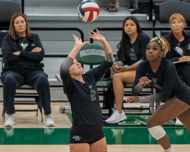 Waxahachie junior Maddie Fuller (2) sets the ball for senior outside hitter Jh'Kyah Head (4) during a Sept. 10 District 11-6A home sweep of Waco High.