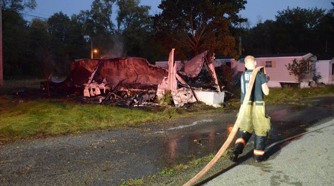 Emmett Township firefighters are investigating a Friday fire at the Avonwood Village mobile home park. (Trace Christenson/The Enquirer))