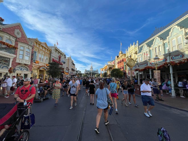 Down on Main Street U.S.A.: The first day of an 18-month celebration of Walt Disney World's 50th anniversary welcomed a Magic Kingdom crowd that started arriving before sunrise.