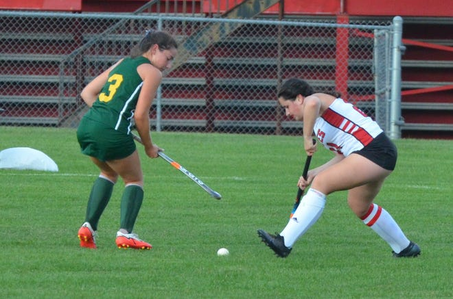 Cinnaminson senior captain Claudia Masciantonio sweeps the ball away from Audubon sophomore Marissa Bower