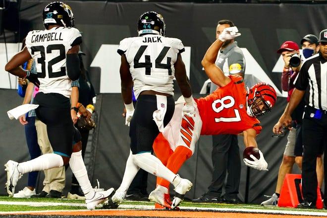 Cincinnati Bengals tight end C.J. Uzomah scores a touchdown early in the third quarter Thursday night against the Jacksonville Jaguars at Paul Brown Stadium.