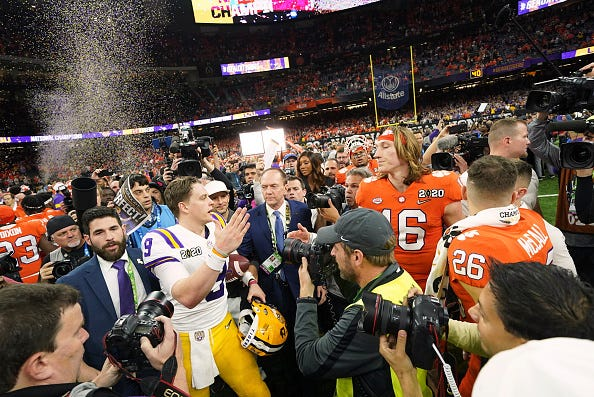 LSU QB Joe Burrow (9) with Clemson QB Trevor Lawrence (16) after the CFP National Championship at Mercedes Benz Superdome in New Orleans on Jan. 13, 2020.