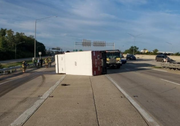 An overturned truck block the interchange between I-75/71 and I-275 Friday morning.