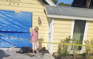 A dog and its family reunited after a fire Thursday, Sept. 30, 2021, in south Lee County. Courtesy San Carlos Park Fire and Rescue District