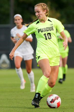 Purdue midfielder Emily Mathews (10) runs with the ball during the first half of an NCAA women's soccer game, Thursday, Sept. 30, 2021 at Folk Field in West Lafayette.