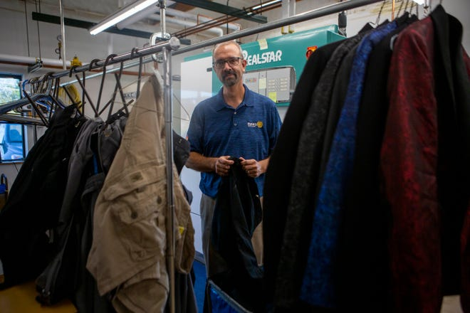 Brad Roach, owner of Fashion and Vanity Cleaners, stands by racks of clothing being pressed and cry cleaned inside of Fashion and Vanity Cleaners in Lancaster, Ohio in September 29, 2021.