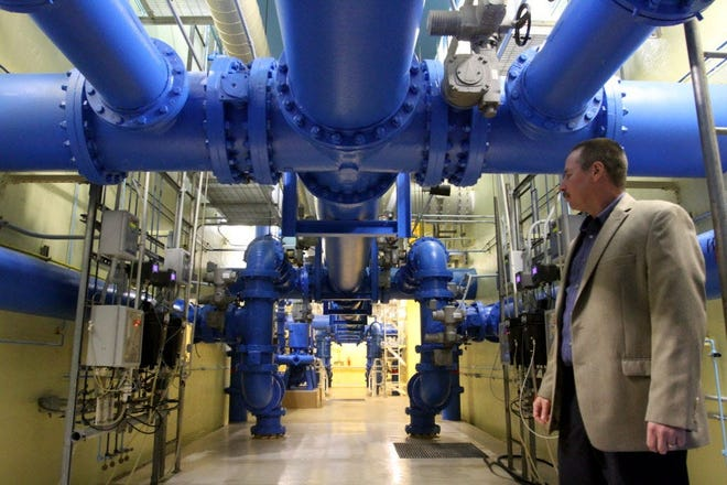 """Oak Creek Water Treatment Plant General Manager Mike Sullivan is seen here among the myriad color-coded pipes beneath the filtration beds that move water in various stages through the plant in 2015. Sullivan said after learning the city in 2021 won the award for best-tasting water in Wisconsin by the Wisconsin Section American Water Works Association that """"this win is also a testament to our great resource, we are so fortunate to have Lake Michigan water."""""""