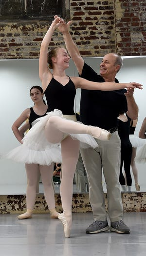 """Dancer Emma Federer is pulled out to demonstrate a pose by teacher Robert Cole as ballet students at The Ballet Academy begin rehearsals for Central Ohio Youth Ballet's annual production of """"The Nutcracker"""". Cole opened The Ballet Academy and Central Ohio Youth Ballet in 1994."""
