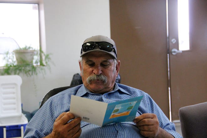 Richard Nunn of the Otero County Road Department reads a card commemorating his retirement from the Road Department at his retirement party September 30, 2021.