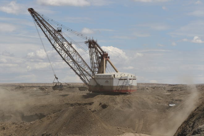 A dragline removes a layer of earth to get to coal in the Dixon Pit on Aug. 1, 2019 at Navajo Mine.