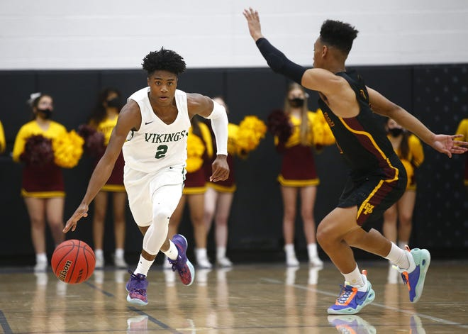 Mar. 20, 2021; Gilbert, Arizona, USA; Sunnyslope's Oakland Fort (2) drives up the court against Mountain Pointe's Jason Kimbrough Jr. (0) during the 6A State Championship game at Mesquite High School. Mandatory Credit: Patrick Breen-Arizona Republic