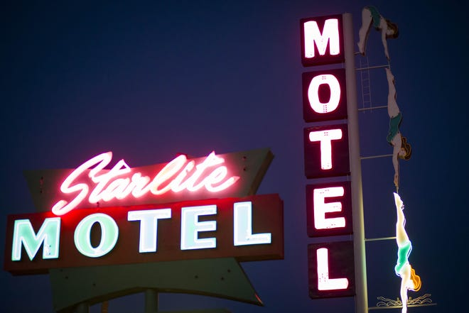 The Diving Lady neon sign is illuminated during a rededication ceremony at the Starlite Motel in Mesa in 2013.