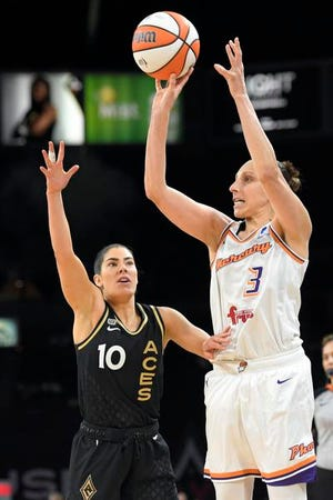 Phoenix Mercury guard Diana Taurasi (3) shoots against Las Vegas Aces guard Kelsey Plum (10) during the second half of Game 2 in the semifinals of the WNBA playoffs Thursday, Sept. 30, 2021, in Las Vegas. (AP Photo/David Becker)