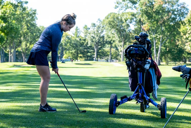 Port Huron Northern's Madi Bajis warms up before practice Thursday, Sept. 30, 2021, at Port Huron Golf Club.