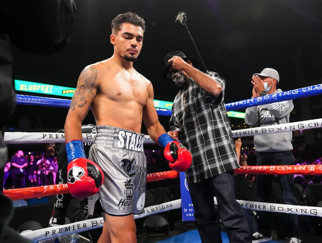 Boxer Justin Cardona,  a 2018 graduate of Everett Alvarez High graduate, gets ready before a fight.
