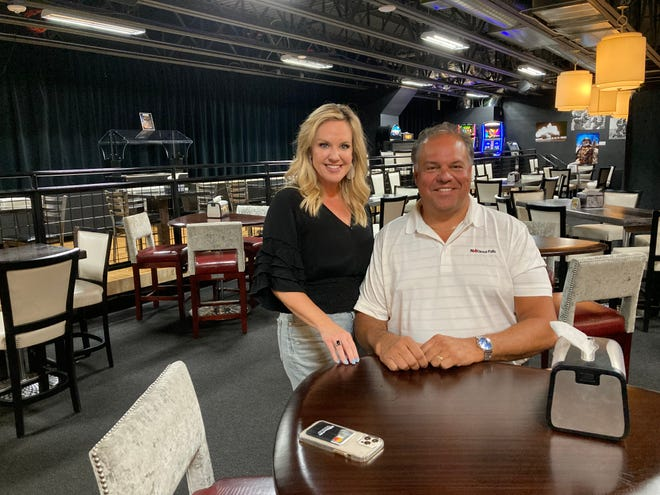Myra and Dale Zomer sit at the Military Heritage Alliance during a watch party for the family's second appearance on 'Family Feud' on Friday, October 1, 2021.