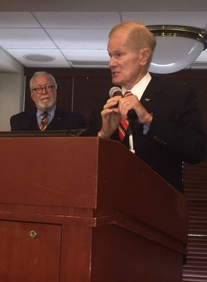 Bill Nelson speaks to the Economic Club of Florida Friday, Oct. 1, 2021, as Club President Barney Bishop III listens.