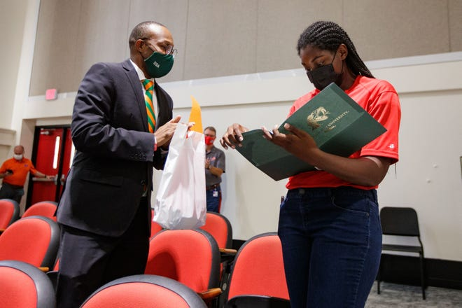 Makeda McKinney, a senior at Leon High School, right, reads her acceptance letter to Florida A&M University Friday, Oct. 1, 2021.