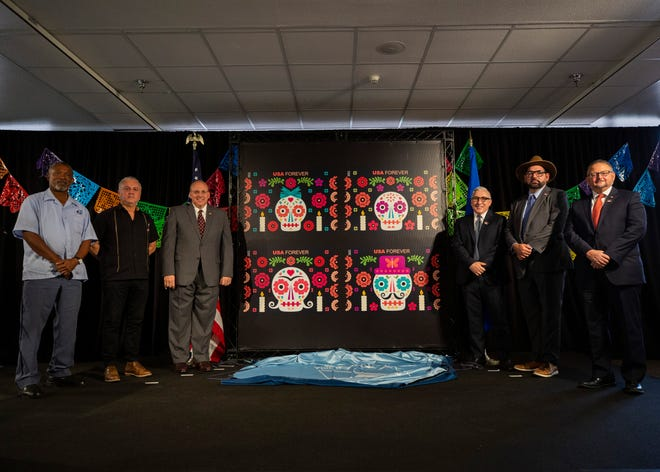 Dignitaries attend as the Day of the Dead U.S. Postal Service stamps are unveiled on the first day of issue at a dedication ceremony at the El Paso Museum of Art on Thursday.